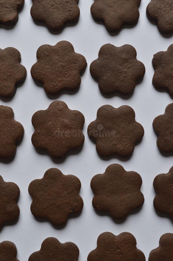 Flower cookies. Homemade dark chocolate flower shaped cookies royalty free stock photography