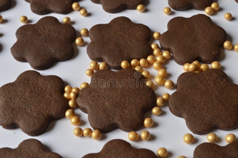 Flower cookies. Homemade dark chocolate flower shaped cookies stock images
