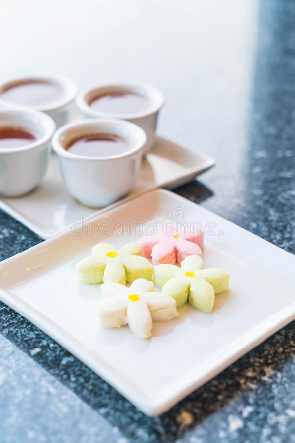 Flower cookies snack with tea. Chinese dessert stock photos