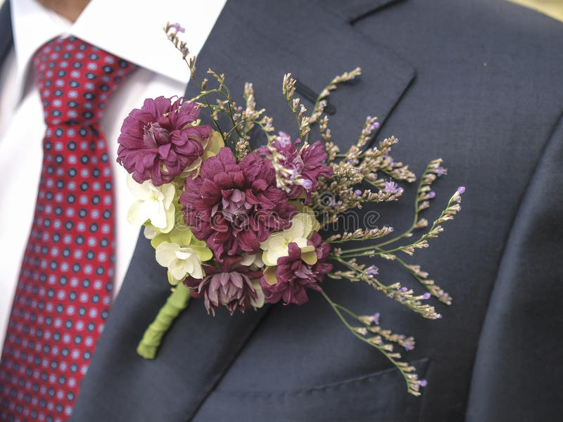 Flower corsage with a tie stock photos