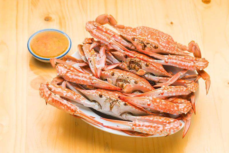 Flower crab group steamed on wood background stock image
