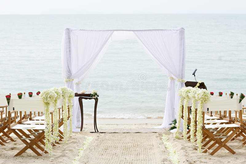 White Chairs At A Wedding Indoor Stock Photo: Flower Decoration Chair On Beach Wedding Venue Stock Photo