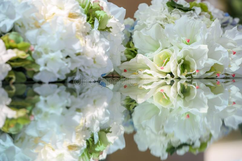 Flower decortion on table. Close up with reflection stock photography