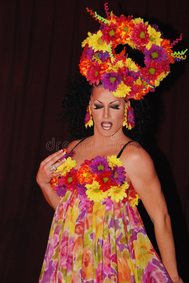 Flower Drag queen. Beautiful Drag queen, wearing a flamboyant flower dress and head piece royalty free stock images