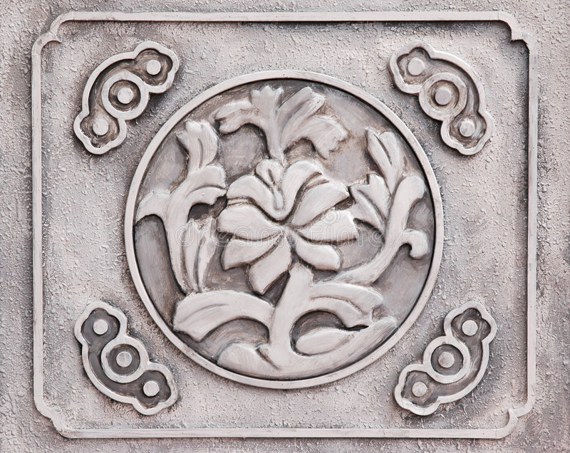Flower engraved on stone stock photos