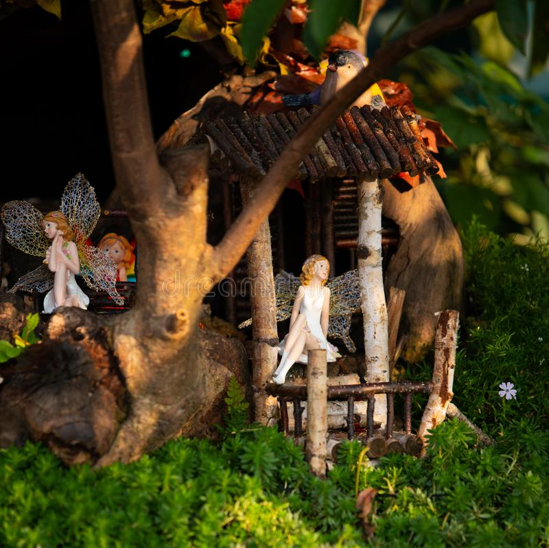 Flower fairy models in a treehouse. Hong Kong, China - March 18th 2018 : Miniature flower fairy models in a tree house, on display at the Hong Kong Flower Show stock images