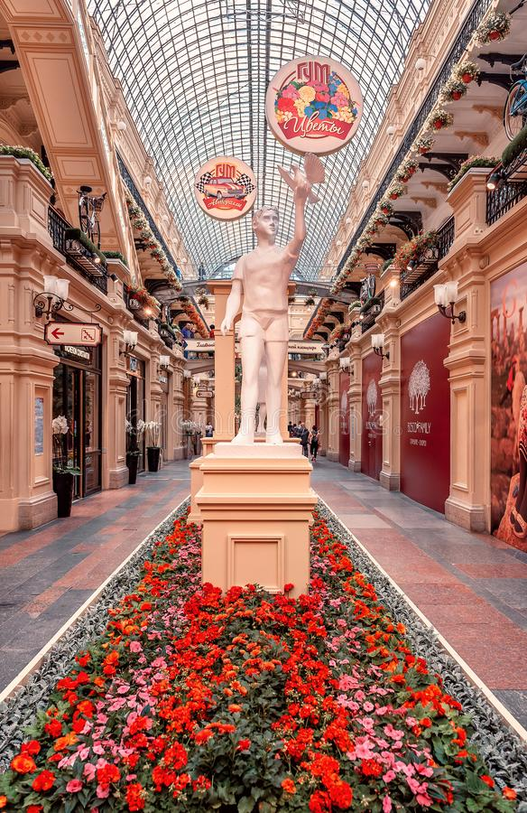 Flower Festival in GUM. Red Square, statues and flowers. MOSCOW, RUSSIA - July 3, 2019: Flower Festival in GUM. Red Square, statues and flowers stock image