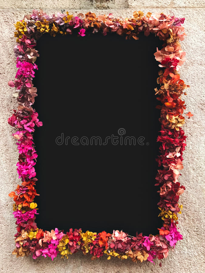 Flower Framed Around Chalkboard On Stone Wall Stock Photo - Image of ...