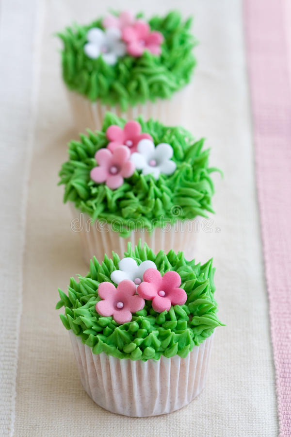 Flower garden cupcakes royalty free stock photography