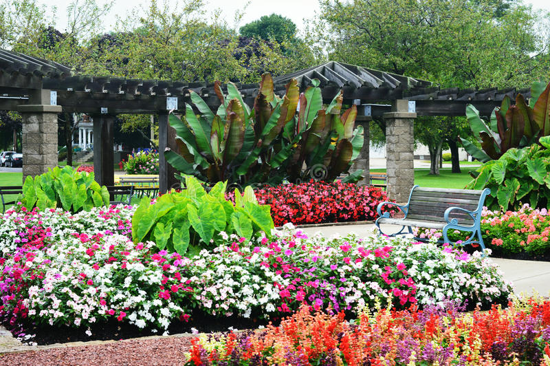 Flower Garden, Eichelman Park, Kenosha, Wisconsin. Beautiful flower garden at Eichelman Park in Kenosha, Wisconsin with a park bench stock photos