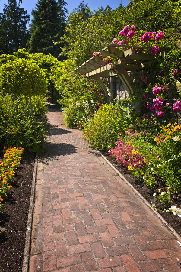 Flower garden with paved path royalty free stock image