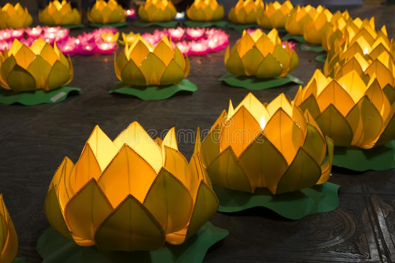 Flower garlands and colored lanterns for celebrating Buddha`s birthday in Eastern culture. They are made from cut paper and candl. E stock photography