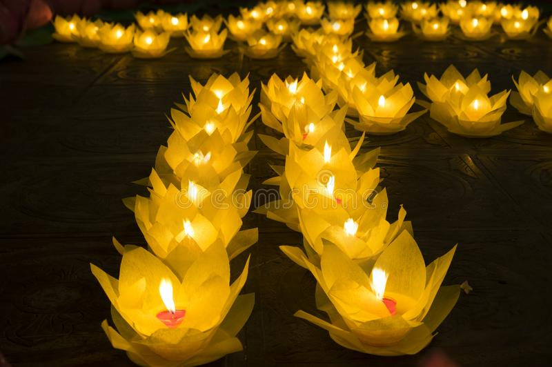 Flower garlands and colored lanterns for celebrating Buddha`s birthday in Eastern culture. They are made from cut paper and candl. E royalty free stock image