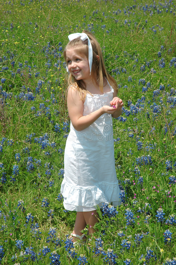 Flower Girl. A beautiful child standing in flowers. Blue Bonnets are native Texas flowers. The Blue Bonnet is the State Flower of Texas, USA stock photos