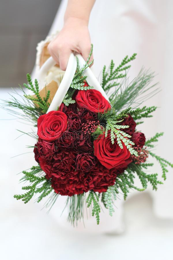Flower girl bouquet, red roses. Flower girl bouquet for wedding, red roses in bag, red, green, white. Bridal, bridesmaid, maid of honour, floral arrangement stock photos