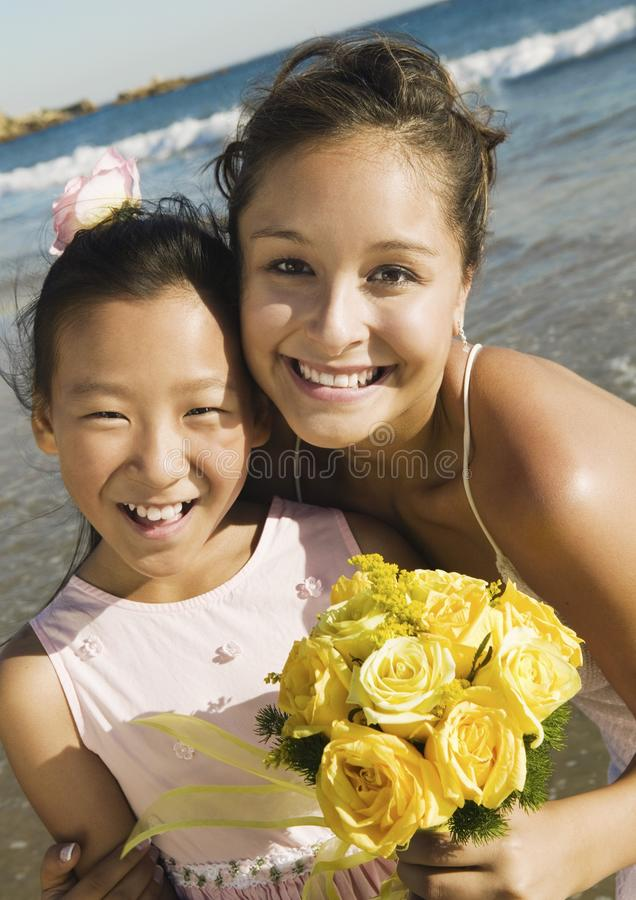 Flower girl and Bride at ocean. (portrait royalty free stock photos