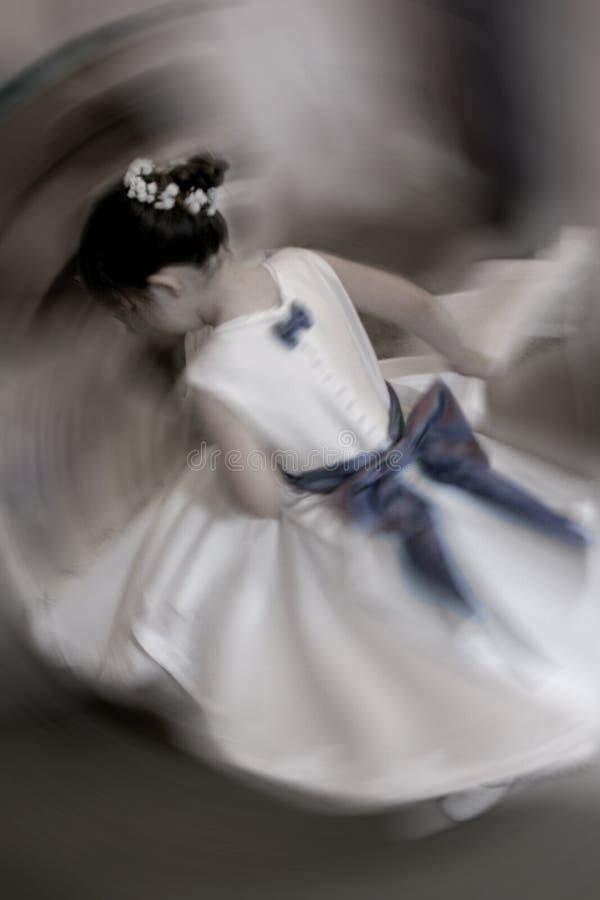 Flower girl spinning stock image