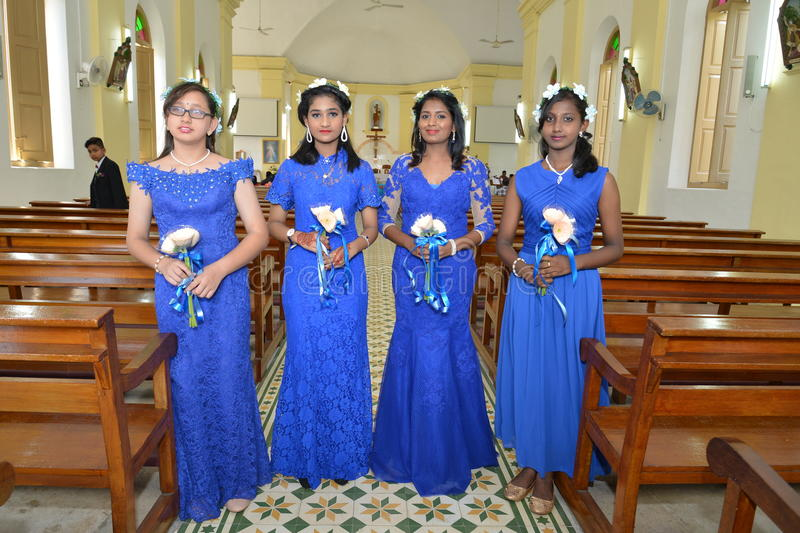 Flower Girls - Church Wedding. Young christian indian flower girls on church wedding day royalty free stock images