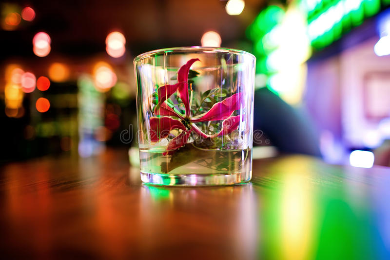 Flower in glass. Is a part of the rastaurant interior royalty free stock photo