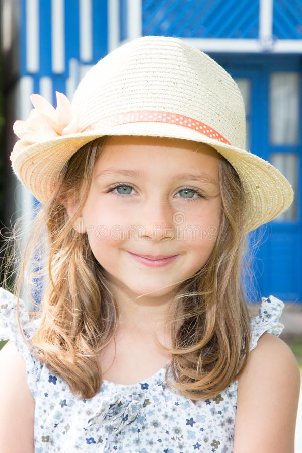 Flower hat in beauty cute child girl portrait. Straw flower hat in beauty cute child girl portrait royalty free stock photos