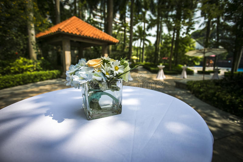 flower High foot table Trees forest sunshine outdoor decoration setting royalty free stock images
