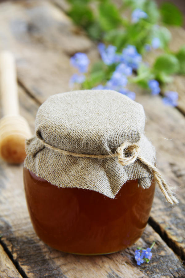 Flower honey in glass jar,. Selective focus stock photography