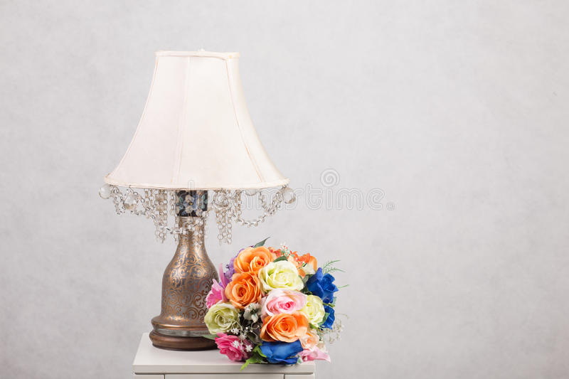 Flower with Lamp on table royalty free stock photo