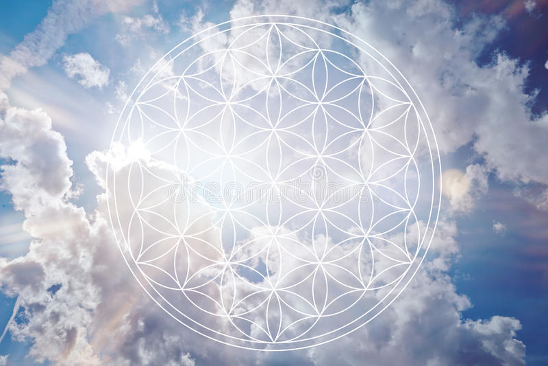 Flower of life in the sky as reiki sign. Flower of life in the sky as holistic reiki sign stock image