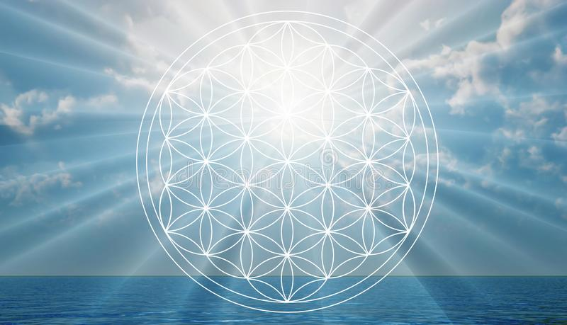 Flower of life symbol in the sky, portal, life. Flower of life in the sky as holistic Reiki sign. Portal to Heaven, another dimension, world. Let go of fears stock photo