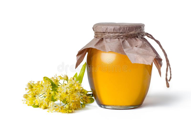 flower of the linden with glass jar of honey Isolated on the white background royalty free stock photography
