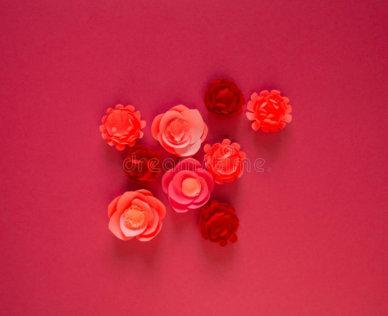 Flower made of paper pink background. Trend color pastel coral. Handwork is a favorite hobby. Florist salon advertising royalty free stock photography