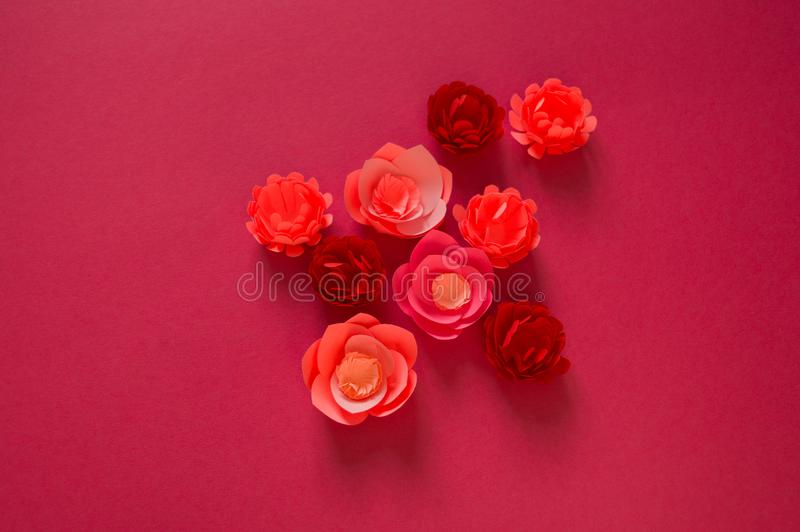 Flower made of paper pink background. Trend color pastel coral. Handwork is a favorite hobby. Florist salon advertising stock images