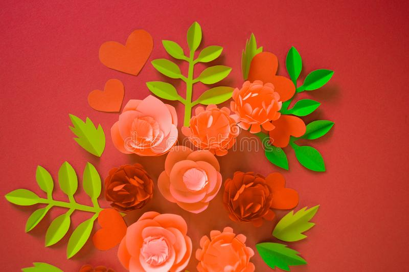 Flower made of paper pink background. Trend color pastel coral. Handwork is a favorite hobby. Florist salon advertising. Green tropical leaf and curl royalty free stock image