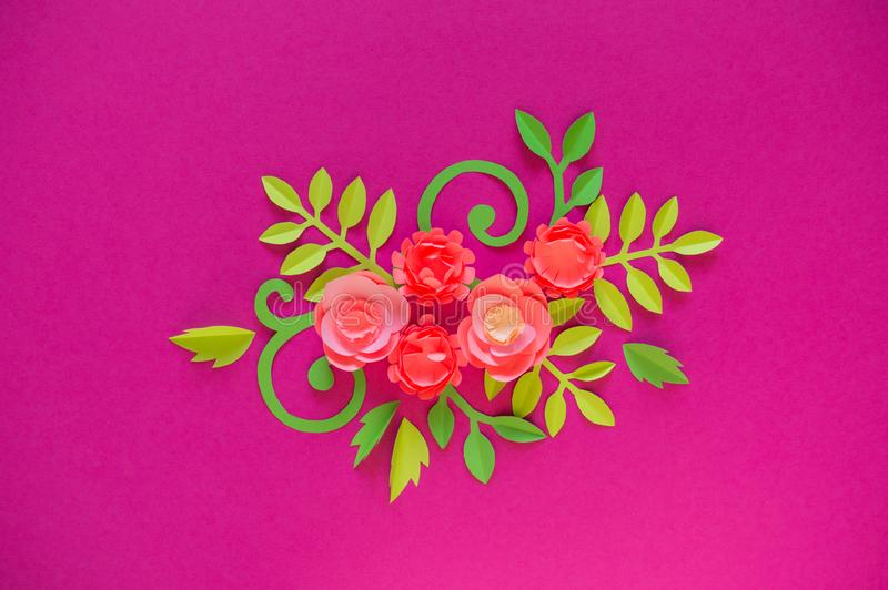 Flower made of paper pink background. Trend color pastel coral. Handwork is a favorite hobby. Florist salon advertising. Green tropical leaf and curl royalty free stock images