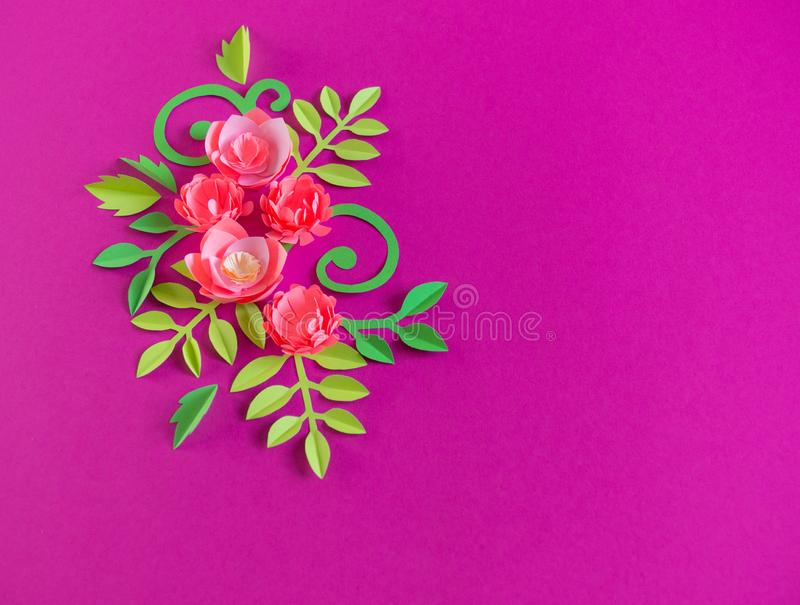 Flower made of paper pink background. Trend color pastel coral. Handwork is a favorite hobby. Florist salon advertising. Green tropical leaf and curl royalty free stock photo