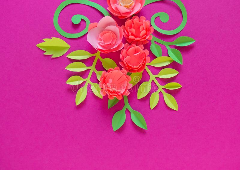 Flower made of paper pink background. Trend color pastel coral. Handwork is a favorite hobby. Florist salon advertising. Green tropical leaf and curl royalty free stock photography