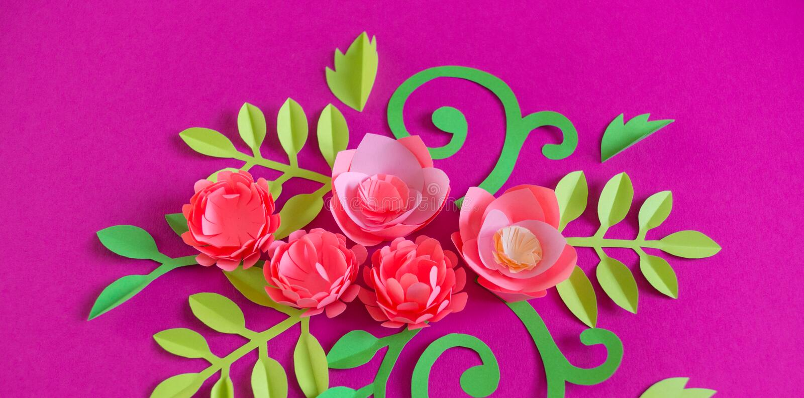 Flower made of paper pink background. Trend color pastel coral. Handwork is a favorite hobby. Florist salon advertising. Green tropical leaf and curl stock image