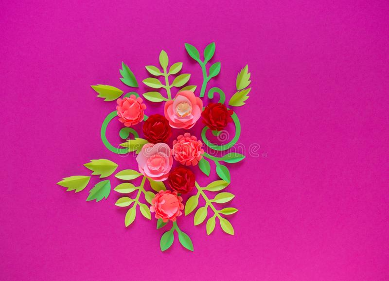 Flower made of paper pink background. Trend color pastel coral. Handwork is a favorite hobby. Florist salon advertising. Green tropical leaf and curl royalty free stock photos