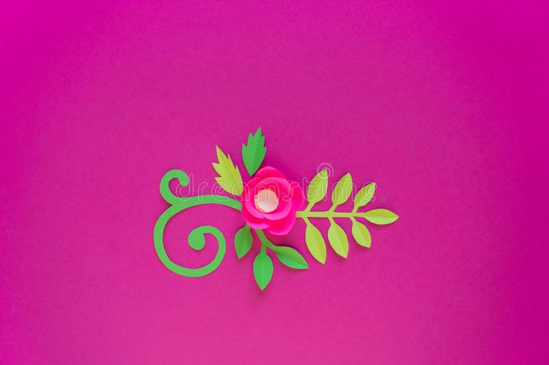 Flower made of paper pink background. Trend color pastel coral. Handwork is a favorite hobby. Florist salon advertising. Green tropical leaf and curl stock photo