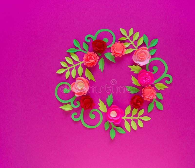 Flower made of paper pink background. Trend color pastel coral. Wreath in a circle. Flower made of paper pink background. Trend color pastel coral. Handwork is a royalty free stock photos