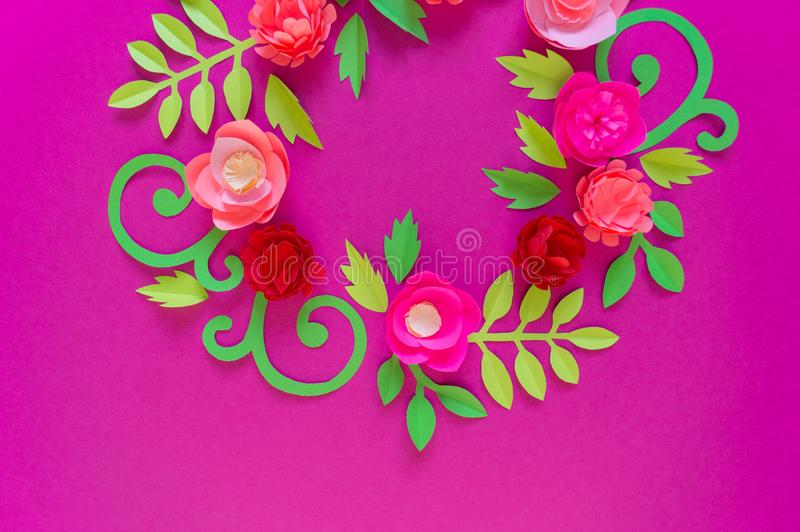 Flower made of paper pink background. Trend color pastel coral. Wreath in a circle. Flower made of paper pink background. Trend color pastel coral. Handwork is a stock images