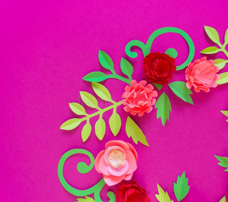 Flower made of paper pink background. Trend color pastel coral. Wreath in a circle. Flower made of paper pink background. Trend color pastel coral. Handwork is a stock photos