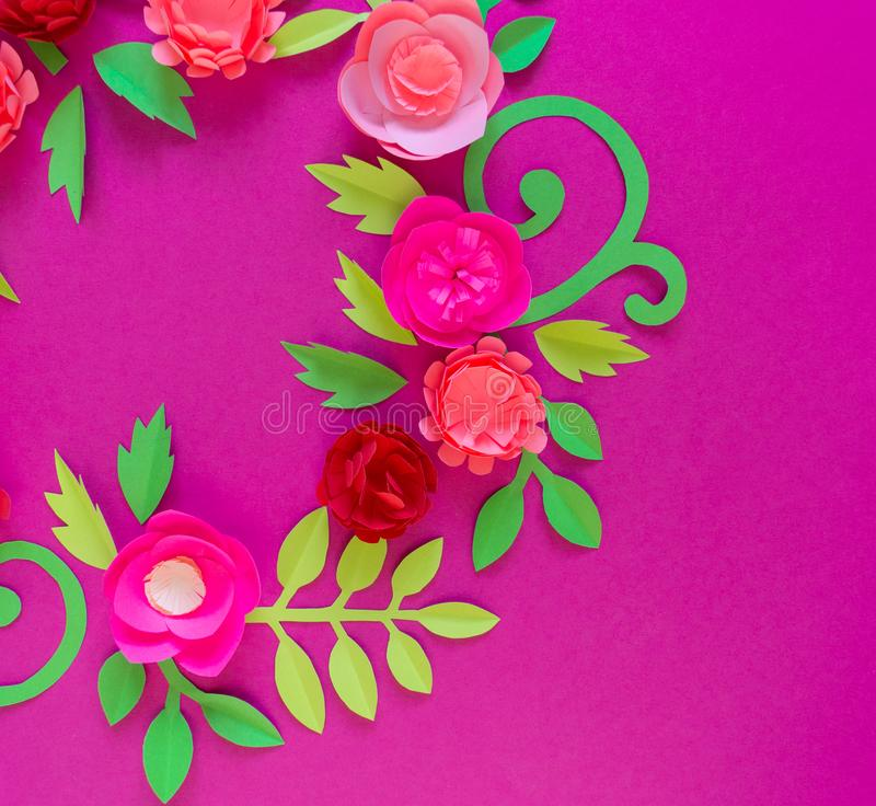 Flower made of paper pink background. Trend color pastel coral. Wreath in a circle. Flower made of paper pink background. Trend color pastel coral. Handwork is a royalty free stock images