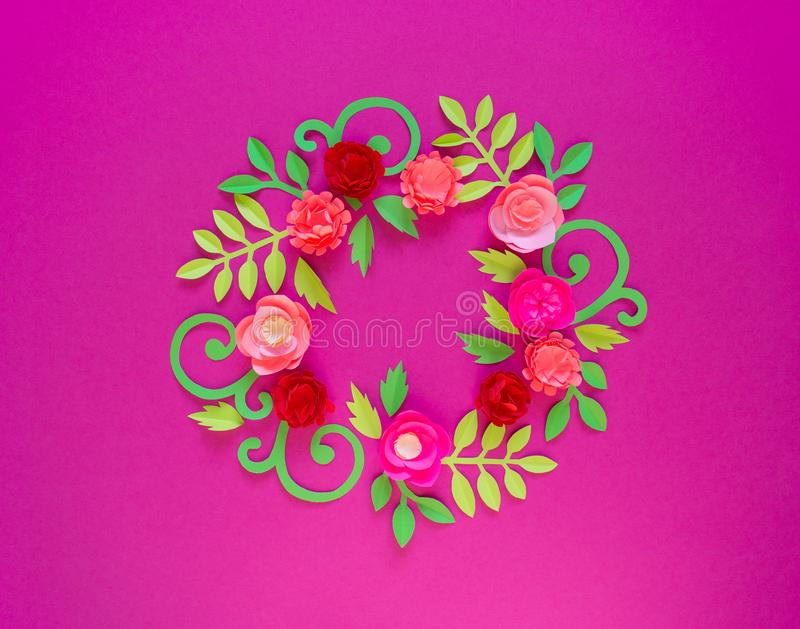 Flower made of paper pink background. Trend color pastel coral. Wreath in a circle. Flower made of paper pink background. Trend color pastel coral. Handwork is a royalty free stock photography