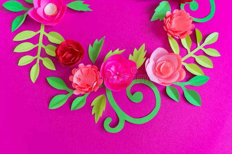 Flower made of paper pink background. Trend color pastel coral. Wreath in a circle. Flower made of paper pink background. Trend color pastel coral. Handwork is a royalty free stock image