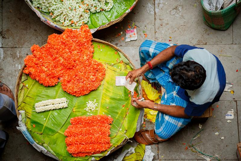 Flower market in Bangalore, India. Man counting money royalty free stock photo