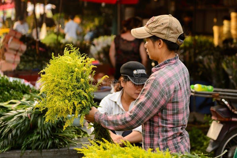 Flower market. HANOI, VIETNAM - SEP 23. 2014: Unidentified man works at the flower market in Hanoi, Vietnam. Flower market in Hanoi is one of the largest flower stock photos