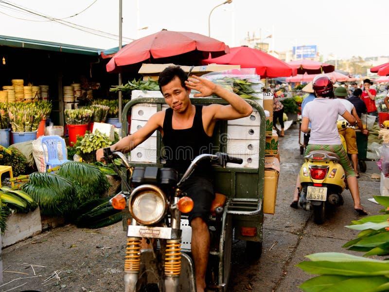 Flower market. HANOI, VIETNAM - SEP 23. 2014: Unidentified man works at the flower market in Hanoi, Vietnam. Flower market in Hanoi is one of the largest flower royalty free stock image