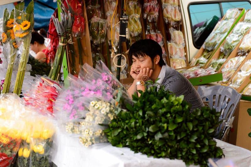 Flower market. HANOI, VIETNAM - SEP 23. 2014: Unidentified man works at the flower market in Hanoi, Vietnam. Flower market in Hanoi is one of the largest flower stock image