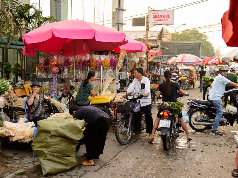 Flower market. HANOI, VIETNAM - SEP 23. 2014: Unidentified Vietnamese people work at the flower market in Hanoi, Vietnam. Flower market in Hanoi is one of the stock photography
